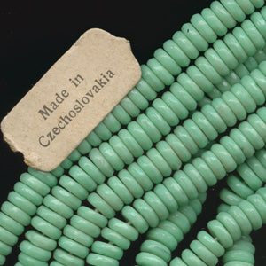 Vintage opaque green turquoise glass flat disks. 1.5x5mm. Pkg. of 50. b11-gr-1034