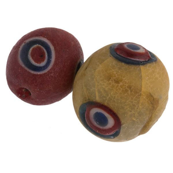 b11-mi-2062- Two ancient Indonesian yellow and red glass eye bead