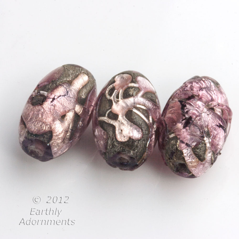 Vintage purple glass bead encased in silver and purple foils. Sold individually. b11-pp-1222