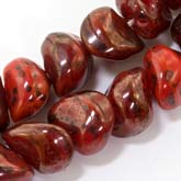 Austrian red, burgundy and black Picasso glass slanted nestling nuggets. 8x5mm. Pkg of 20. b11-rd-0754(e)