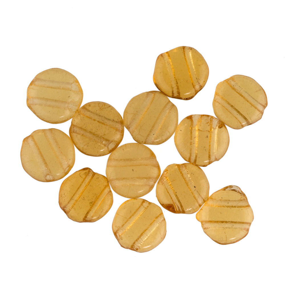 Old Bohemian amber glass two-hole disks. 7mm. Pkg of 25. b11-yo-0824(e)