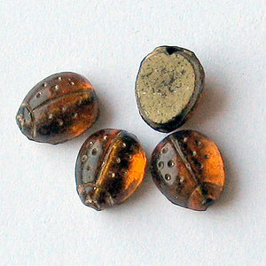 Old Bohemian foiled amber flat back molded ladybug beads verticle hole 9x6mm pkg of 4. b11-yo-0929(e)