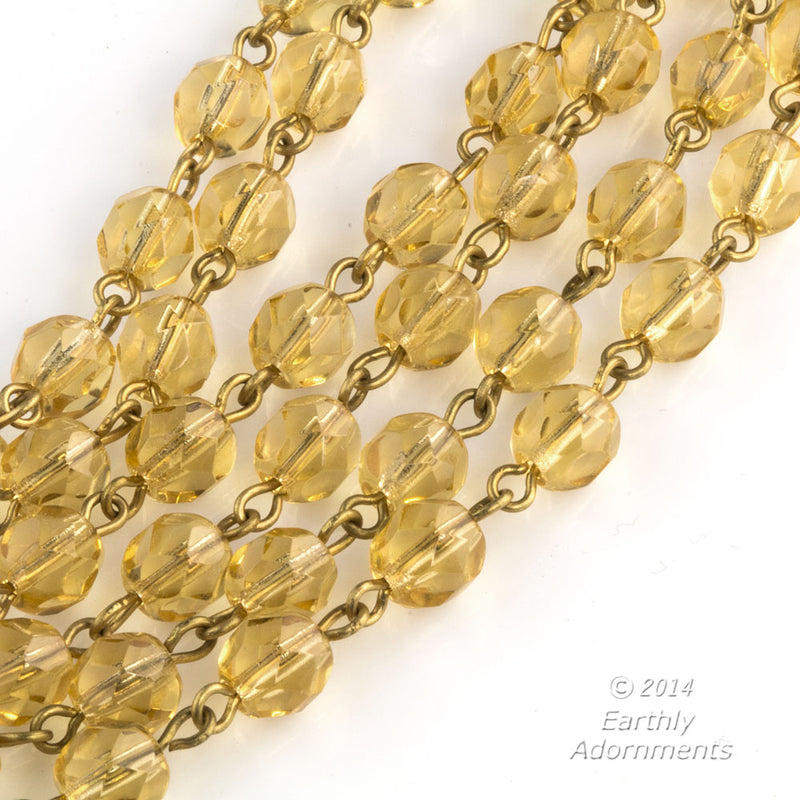 Czech chain of pale amber faceted glass beads and brass wire.