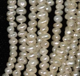 "10"" strand of tiny potato seed pearls, 1.5x2.5mm. b15-prl102(e)"