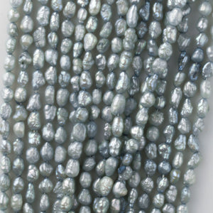 Vintage color treated iridescent freshwater oval rice pearl. Avg. 5x3mm, 16 inch strand. b15-prl112