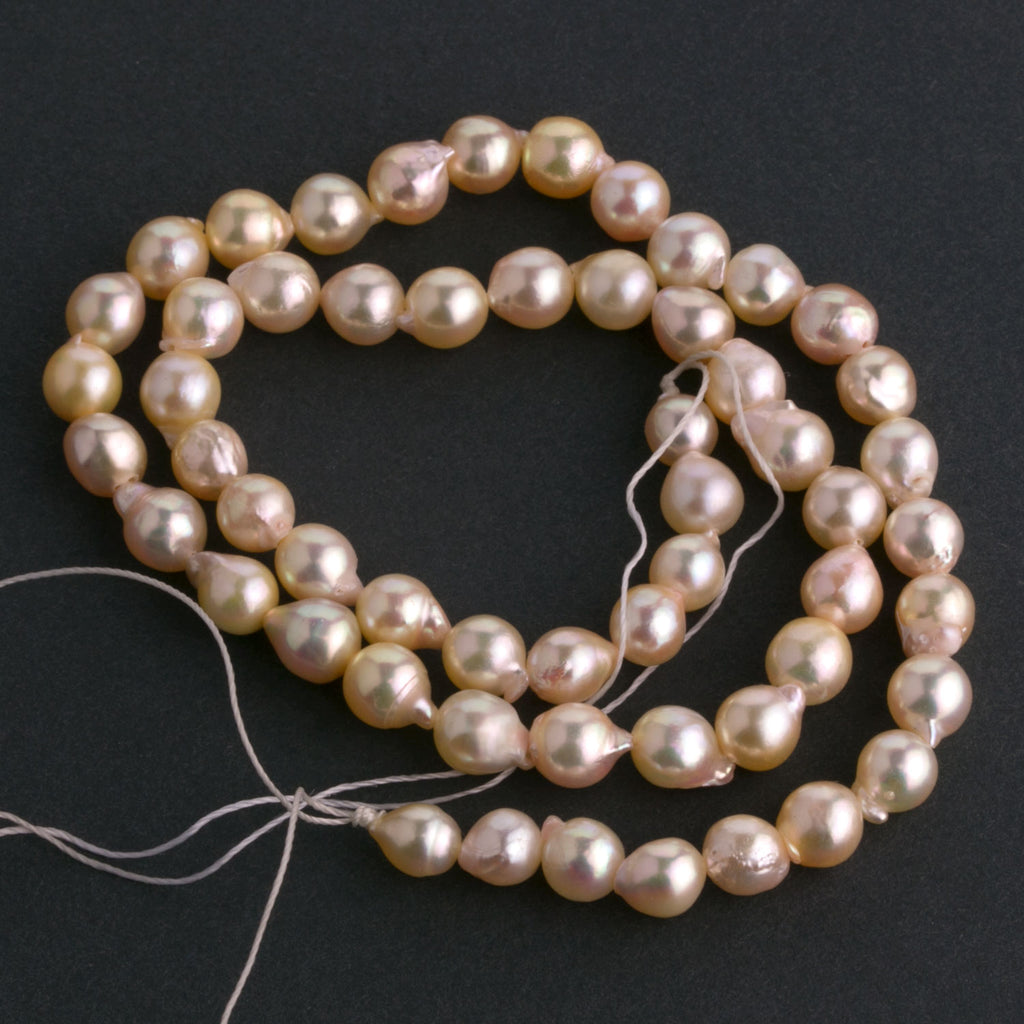 "9"" strand of genuine Japanese Lake Biwa semi baroque 6mm pearls. b15-prl121"
