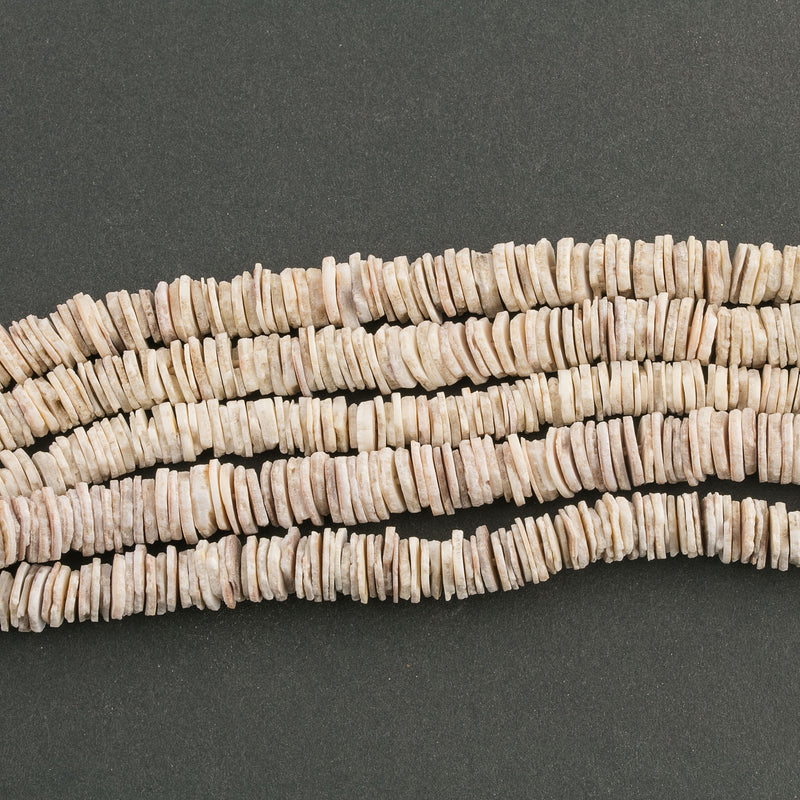 Old West African clam shell heishi. 7-10mm diameter. 15 inch strand. b15-she353cs