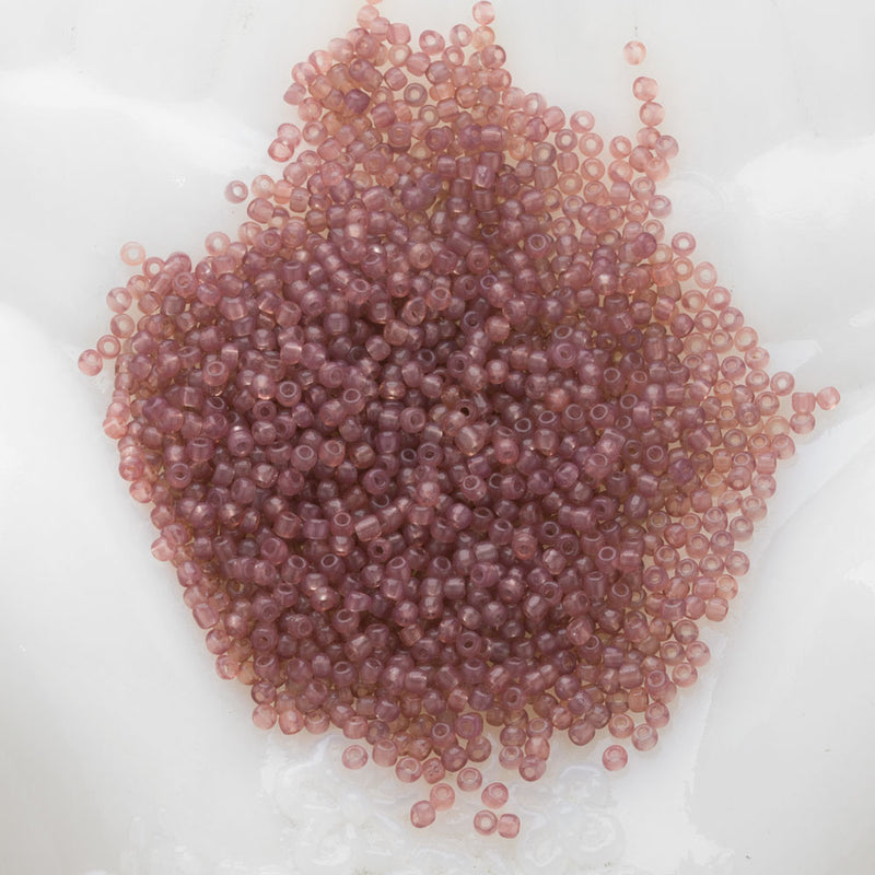 18th century French opalescent seed bead. 10 gram bag. Size 11. b17-044