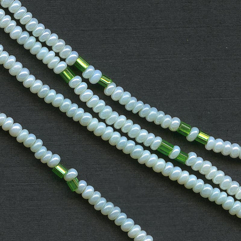 b17-104-Antique Italian pale green 11/0 seed beads with interspersed emerald green foil lined. 8 grams