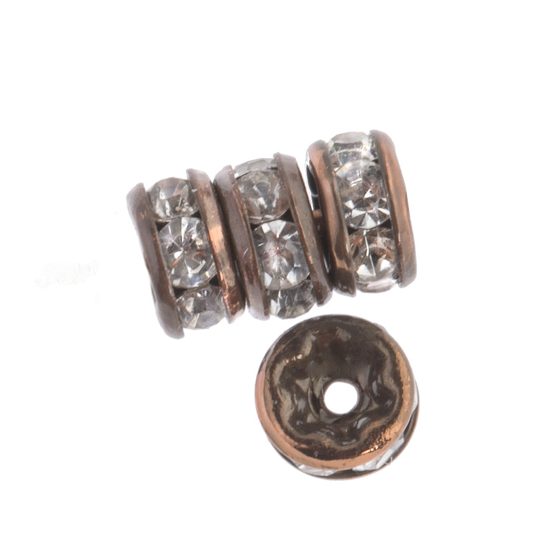 Clear rhinestone rondelle with antiqued copper. 6mm. Pkg of 4. b18-0270-2