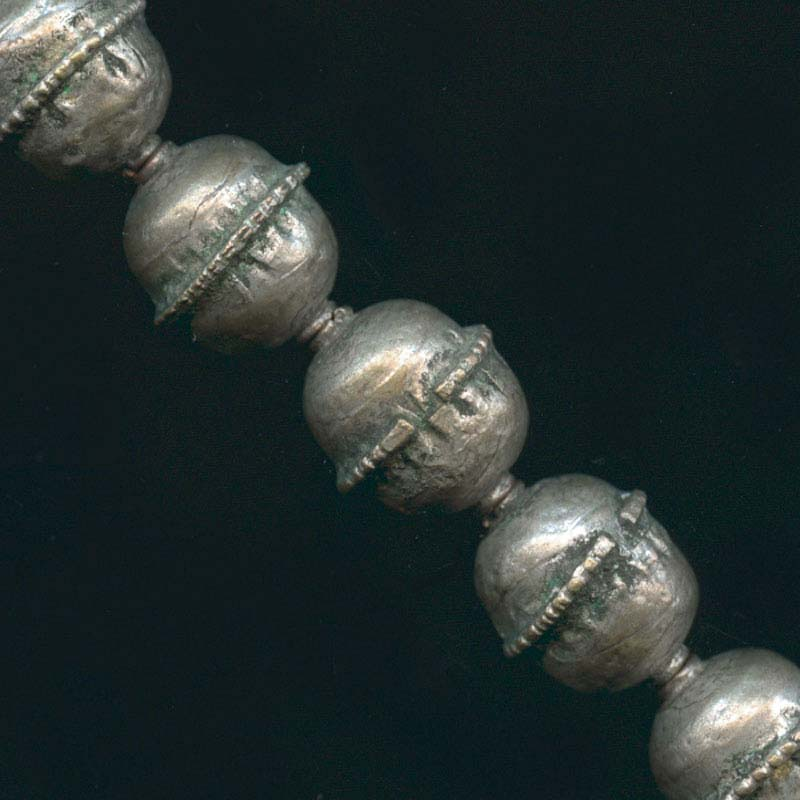 b18-0310-Hollow silver metal bead, 17x10mm. Ethiopia. Sold individually.