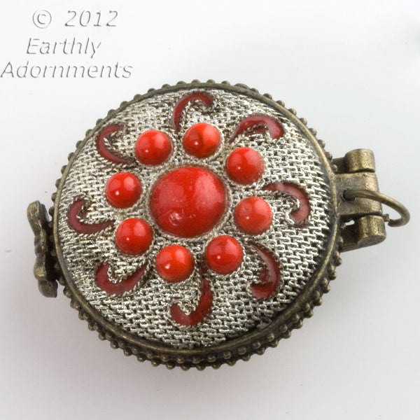 Silver on copper lacey filigree locket with red glass stones.