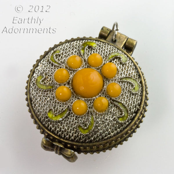 Silver on copper lacey filigree locket with mustard glass stones.
