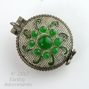 Silver on copper lacey filigree locket with jade glass stones.