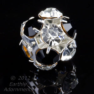 Silver plated crystal and jet machine cut rhinestone bead ball.