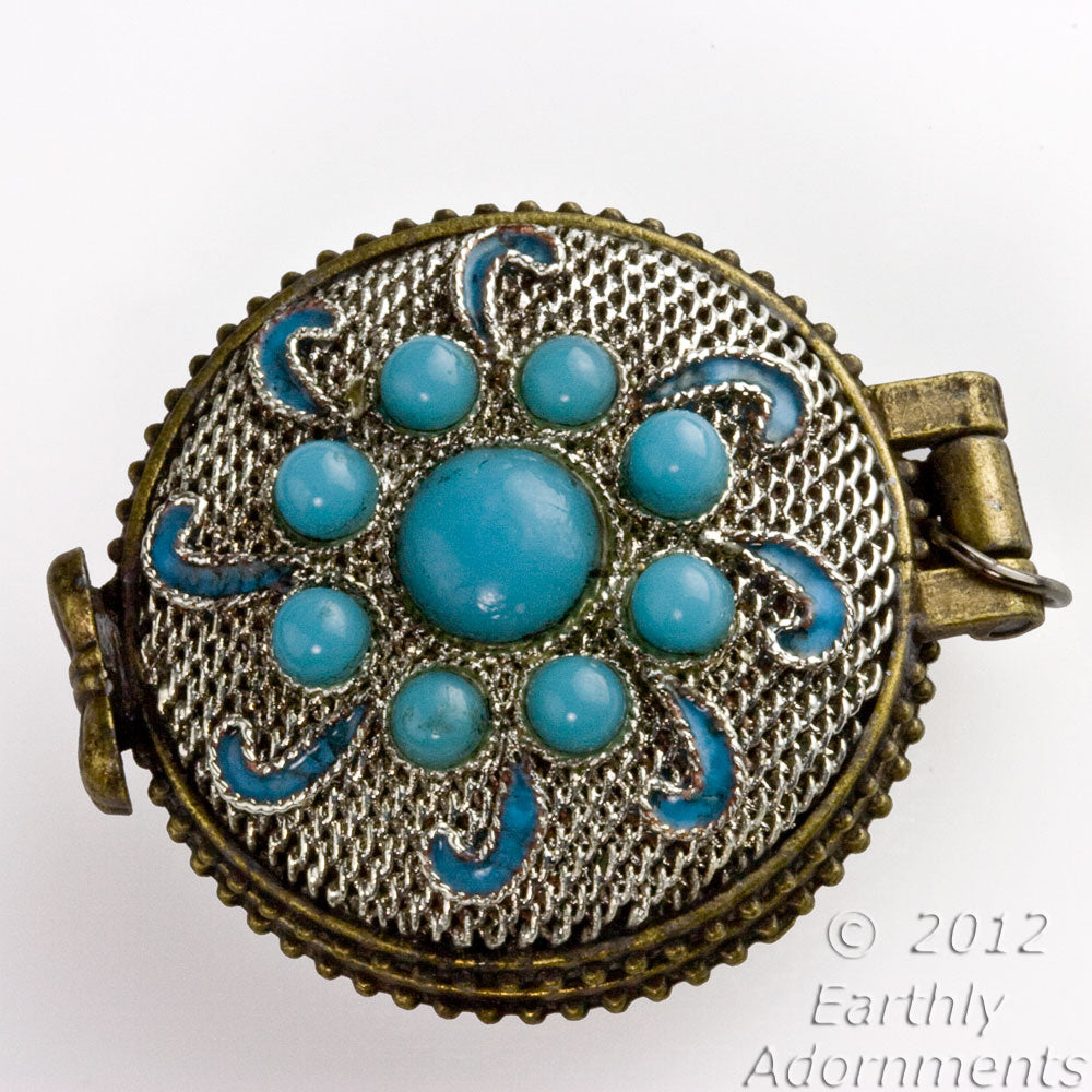 Silver on copper lacey filigree locket with turquoise glass