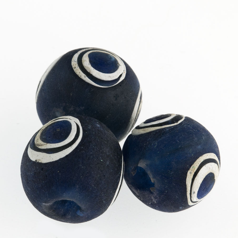 Ancient Indonesian dark blue glass eye bead reproduction. 18-20mm. Sold individually. b1-818-3