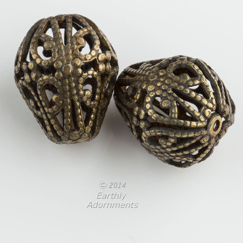 Oxidized brass pear shaped filigree bead. Measures 22x18mm. Package of 2.
