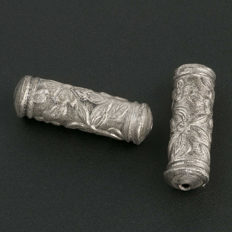 Silver plated hollow cylinder with stamped floral design. 20x6mm with 1mm hole. Sold individually. b18-583