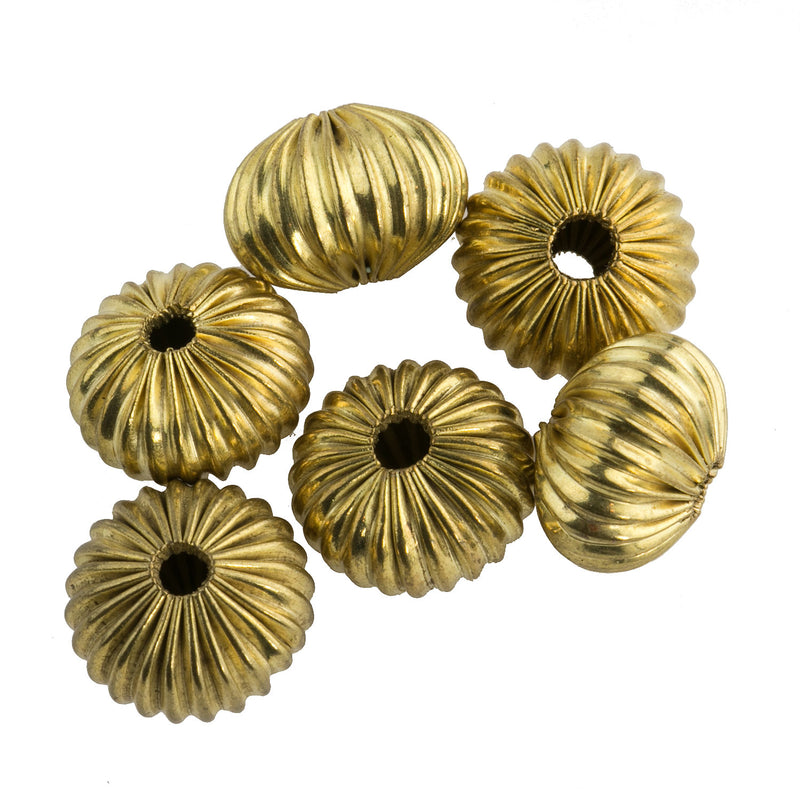 Corrugated raw brass pumpkin shaped bead. 9x12mm. Pkg 6. b18-626