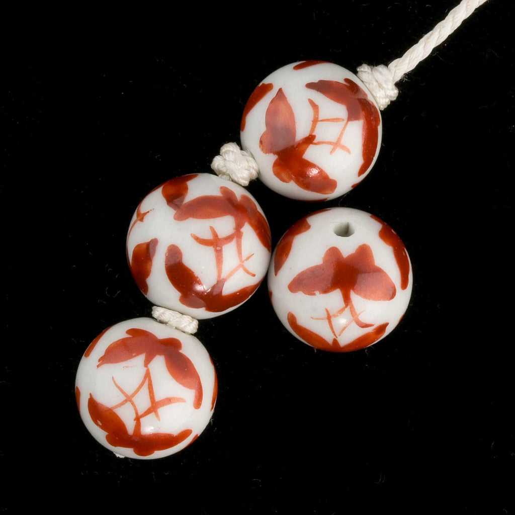 Chinese white porcelain rounds with butterfly motif. 14mm. Pkg of 4. b2-357-2