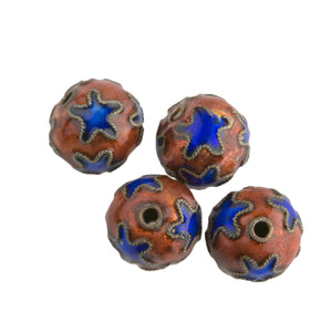 Hollow copper beads with blue stars on persimmon colored enamel. 10mm. Pkg. 2. b2-638