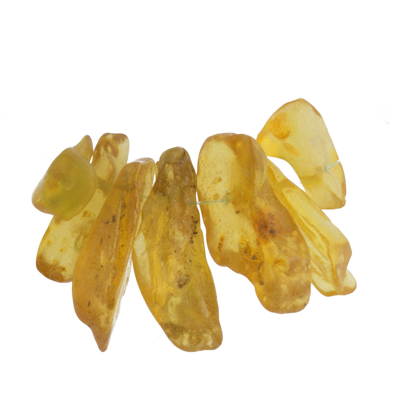 A strand of 7 natural Copal Amber shard beads. b4-amb096-5