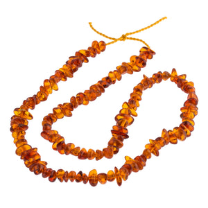 "Vintage natural graduated 19.5"" strand of Cognac Baltic Amber smooth polished freeform beads. b4-amb100cs"