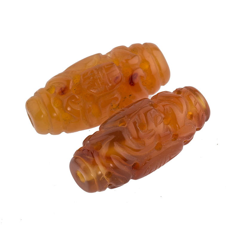 Hand carved translucent carnelian barrel, 30x12mm. Sold individually. b4-car305