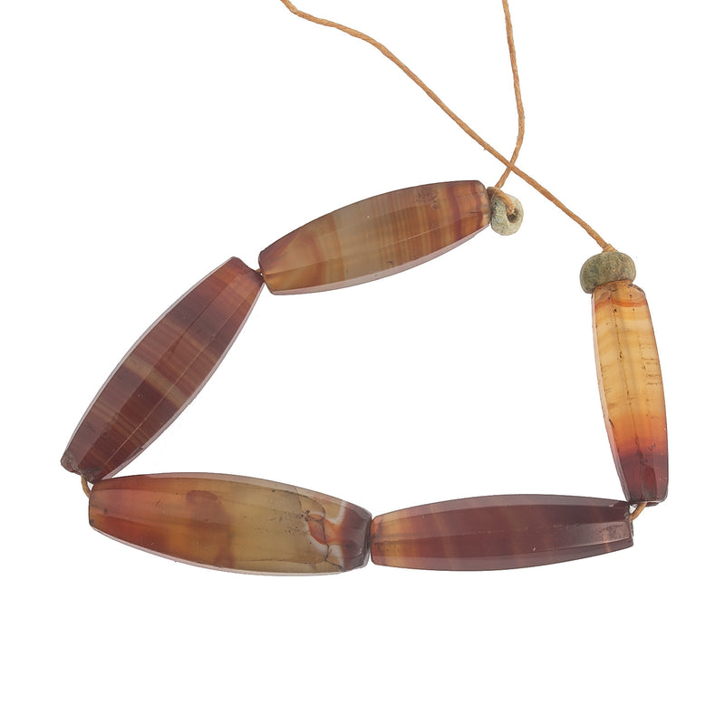 19th century faceted carnelian agate trade beads, cut in Germany, traded in Africa group of 5 beads. b4-car329