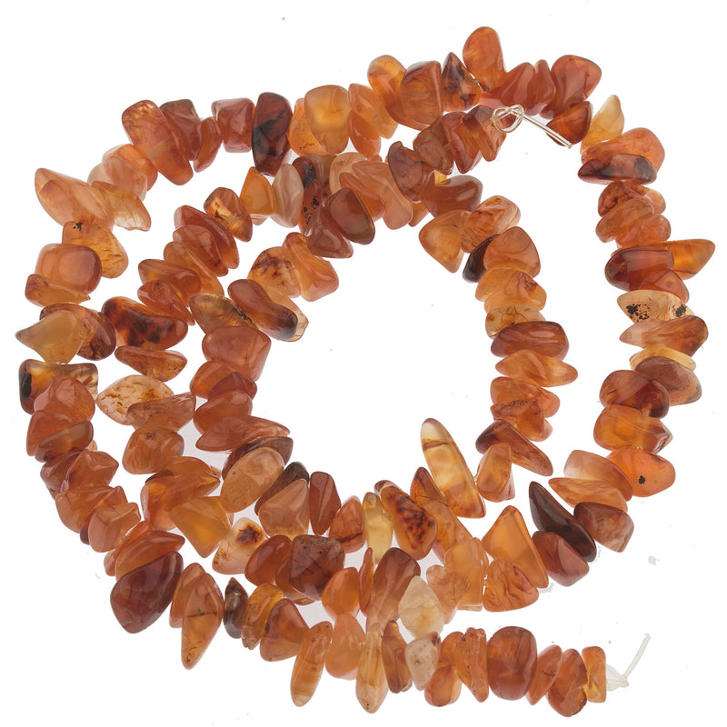 Vintage natural carnelian agate chips 7-11mm. 16 inch strand. b4-car335