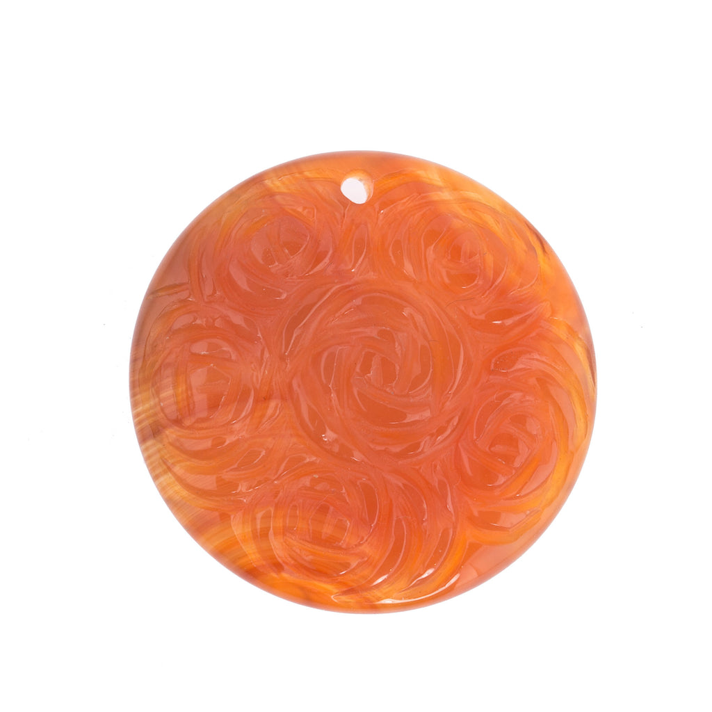 Carved  natural translucent carnelian disk pendant.  Flower design. Two-sided.  36mm x 7mm. b4-car340