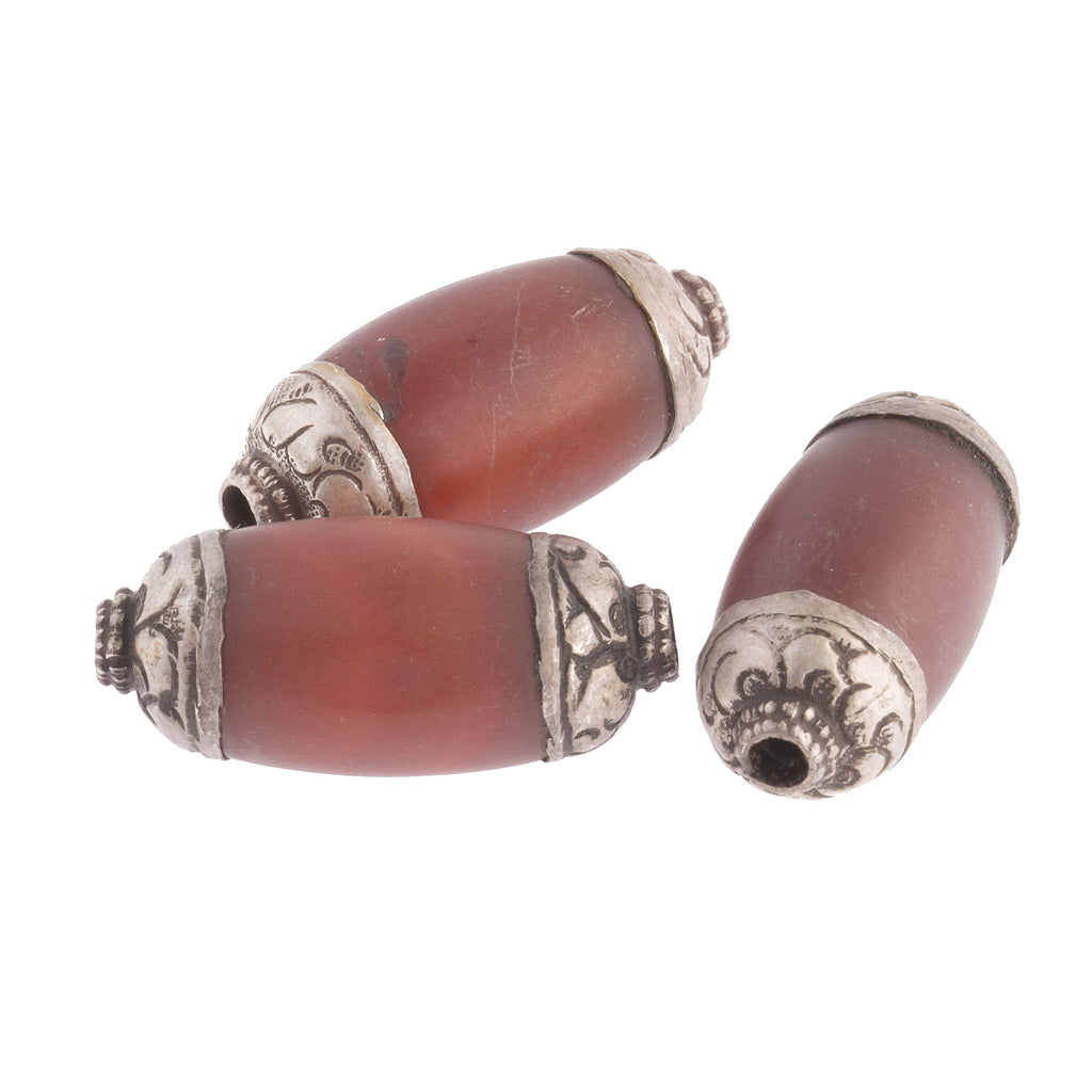 Vintage carved natural opaque dark orange carnelian oval  beads with repoussé silver caps.30x14mm. 2pcs. b4-car356
