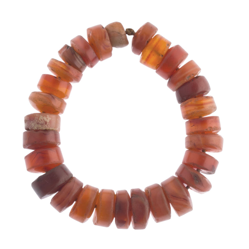 Superb strand of 28 excavated carnelian disk beads.13-16mm diameter. b4-car365cs