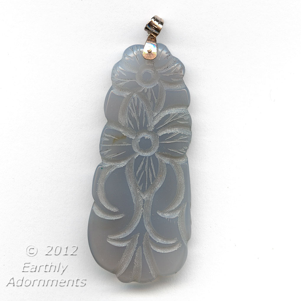 Natural old stock grey-blue chalcedony carved pendants. 14k bail.