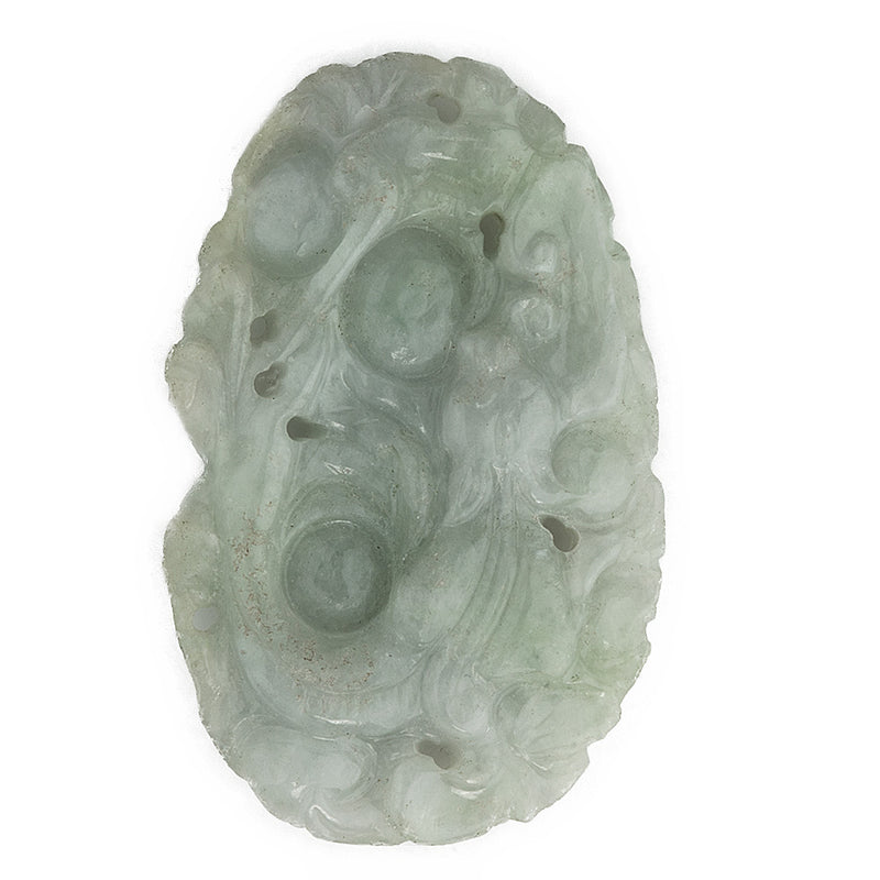 Vintage carved jadeite pendant depicting animal head in the leaves