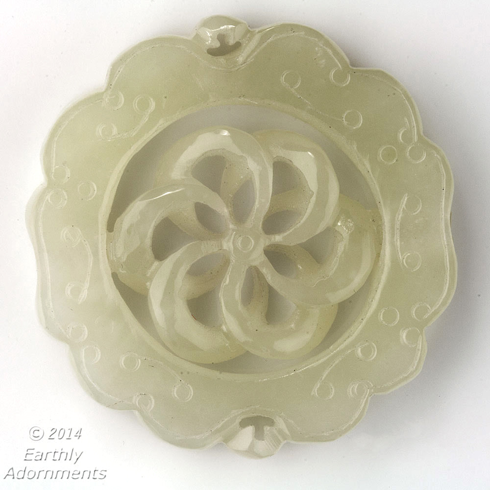 Vintage carved translucent pale green serpentine circular pendant