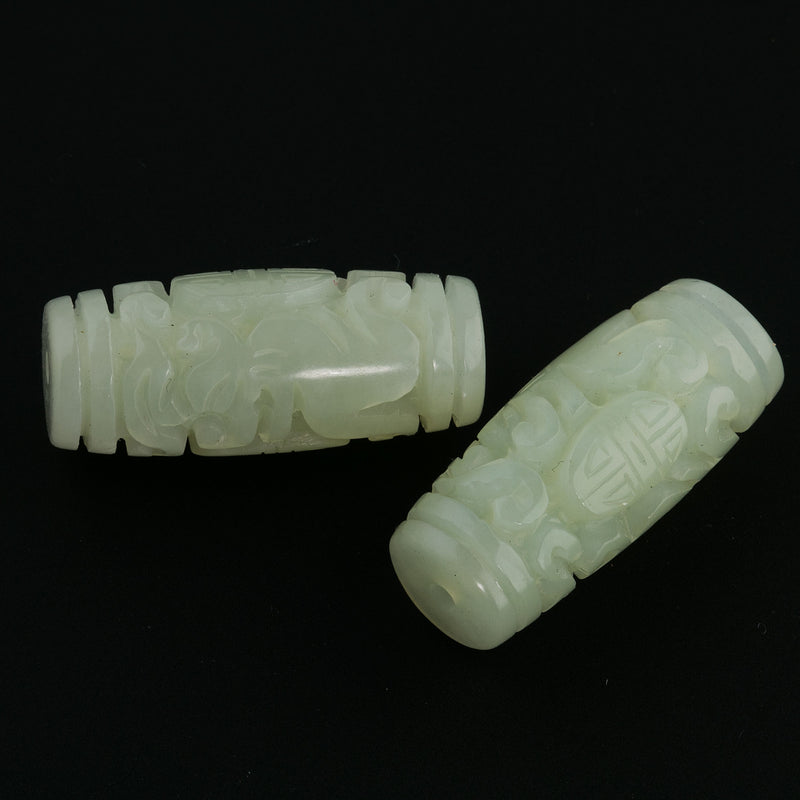 Carved translucent light green Hsiu Jade serpentine cylinder bead. 32x14mm. Sold individually. b4-ser472