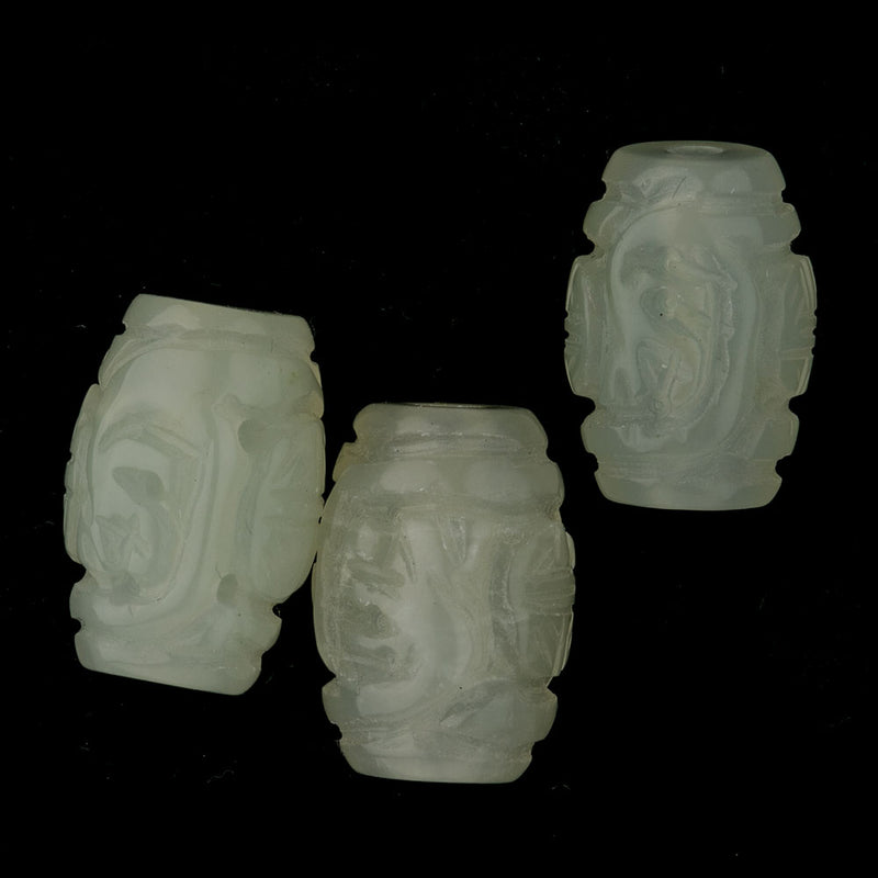 Deep carved and pierced light green Hsiu Jade serpentine barrel bead. Sold individually. b4-ser480