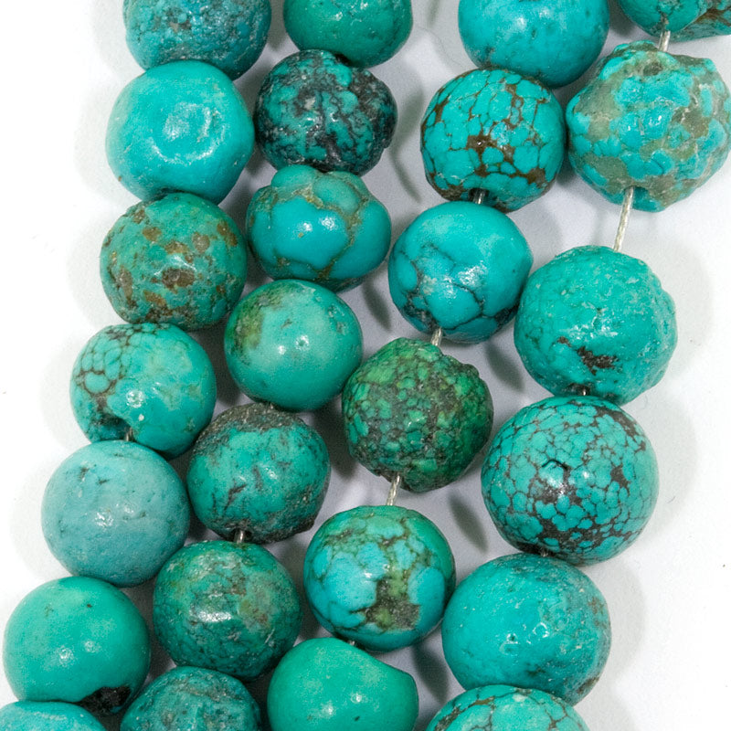 Chinese matrix turquoise rounds. Average 6mm. 4.5