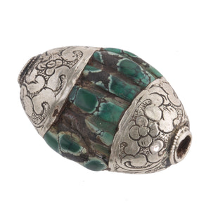 Antique Tibetan carved flattened oval turquoise melon bead with sterling silver caps.  33x21x12mm . b4-tur461
