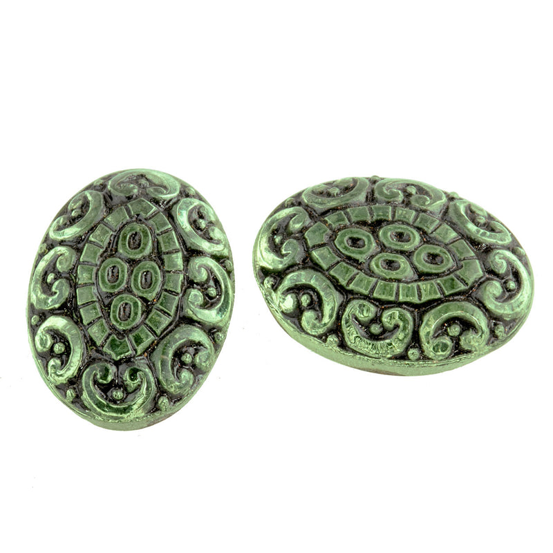 Pressed light green foiled German glass oval cabochon with black enamel. 15x13mm.  Pkg 2. b5-974