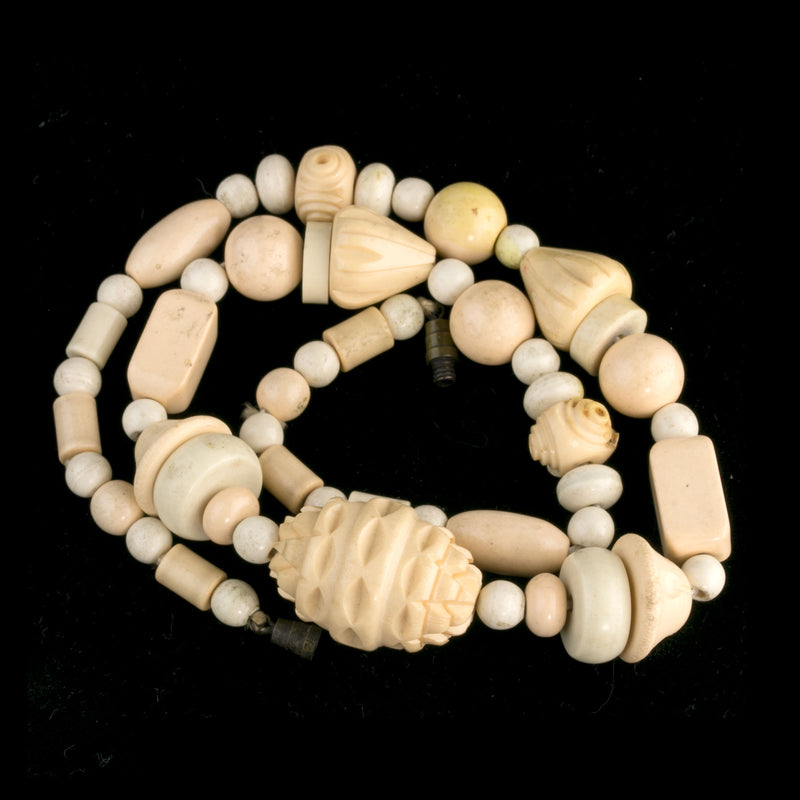 Vintage strand of carved and smooth celluloid beads. c. 1930s. b6-232