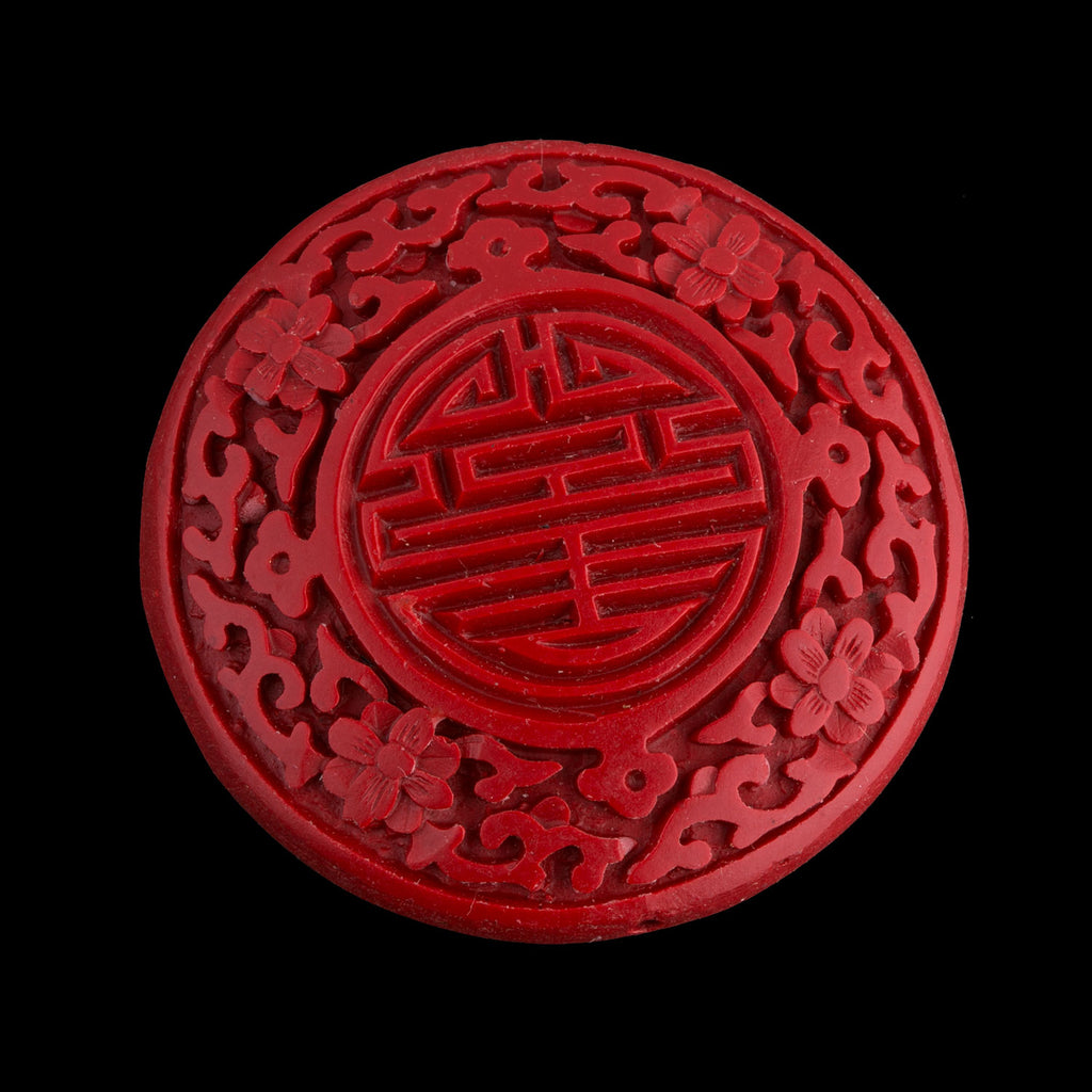 Carved red cinnabar disk. 55mm pkg of 1. B7-CIN017(e)