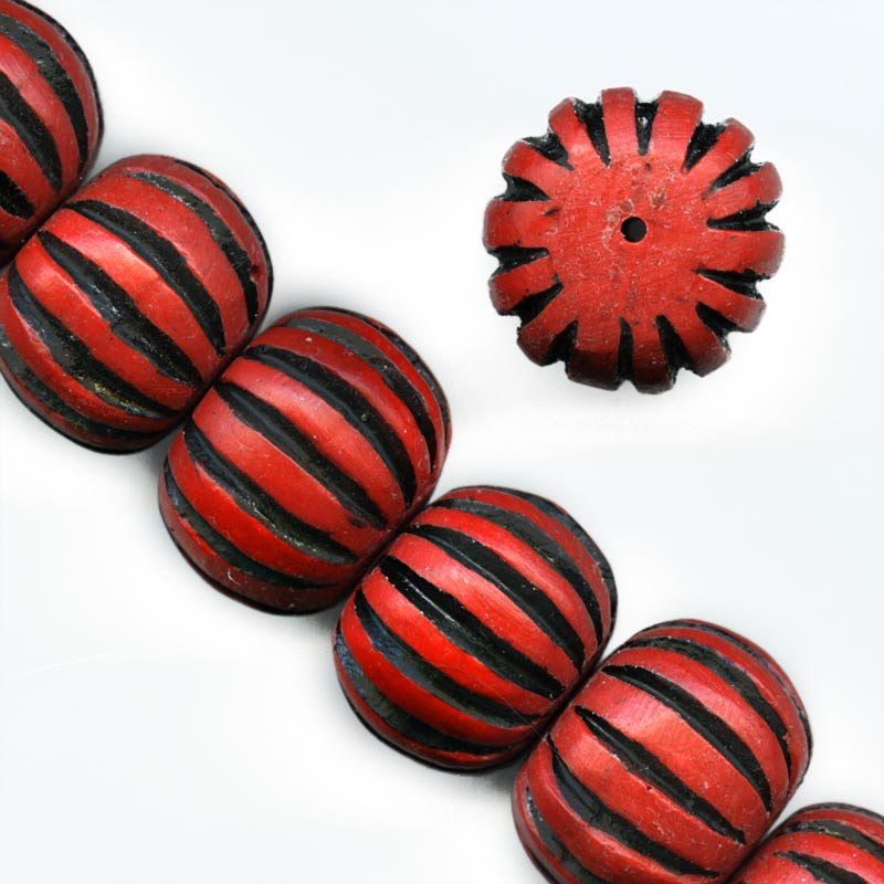 Carved cinnabar red on black pumpkin shape bead. 15x20mm. Pkg of 1. b7-cin211