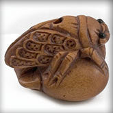Hand carved boxwood cicada on peach ojime bead. 18x22mm. Pkg. of 1.B7-WO204(e)