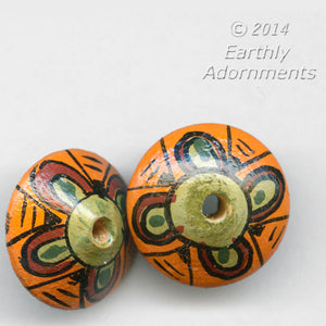 Vintage hand painted wood saucer shaped disk beads. 10x14mm.