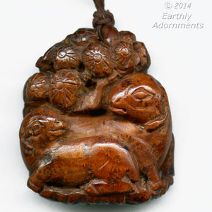 Vintage Chinese carved burl wood pendant with sheep and lamb on flowering shrub. Sold invidually. b7-wo296