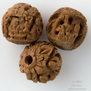 Old Chinese carved Hedaio seed beads tiny amazing carvings 12-14mm.pkg of 2.