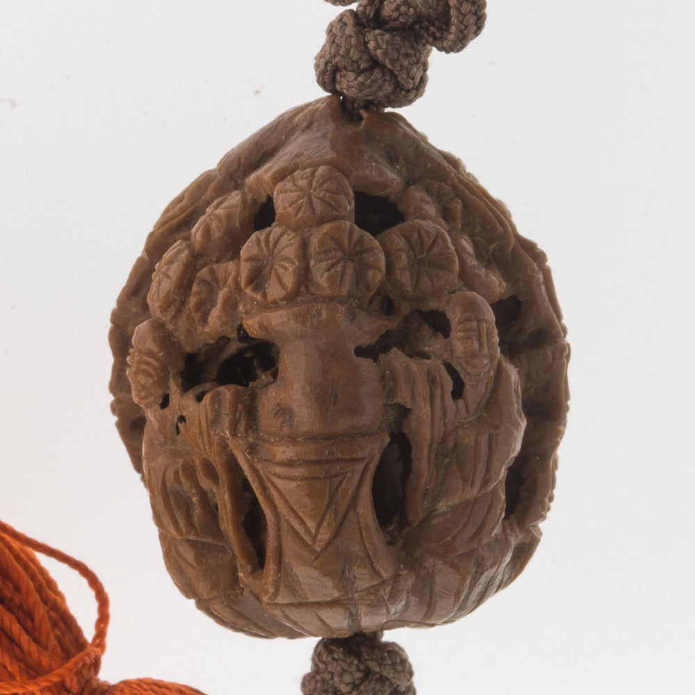 Vintage hand carved walnut shell beads depicting monks and leaves, with pang knot and tassel. b7-wo336(e)